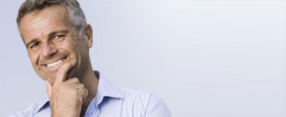 Dental Crowns Raleigh Dental Bridges Middle-aged Man in Blue Shirt Smiling