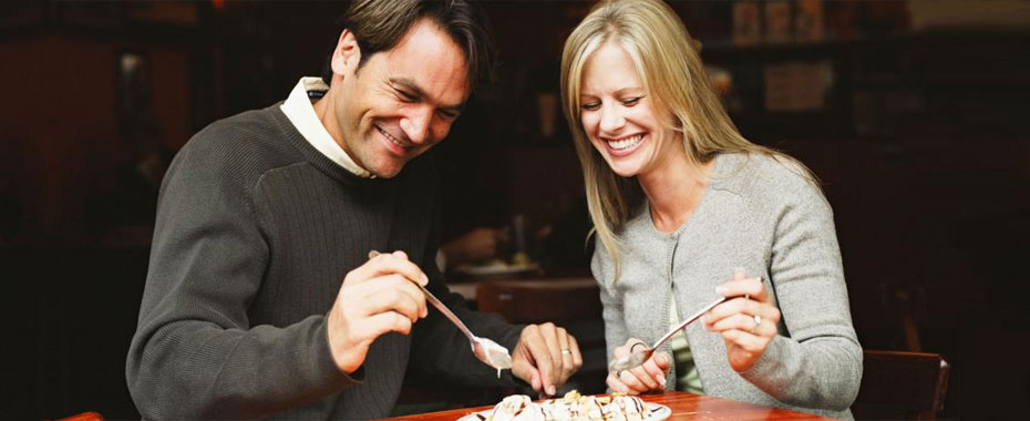 Dental Implants Raleigh Smiling Man and Woman Eating Ice Cream