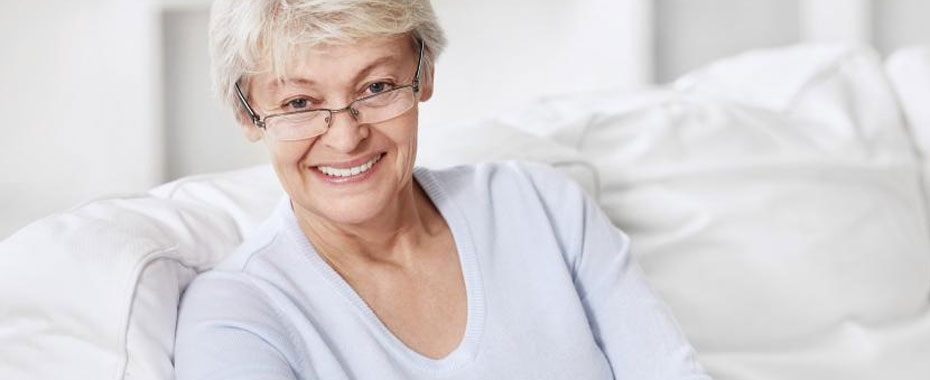 Dentures Raleigh Smiling, Older Grey-Haired Woman in Blue Sweater