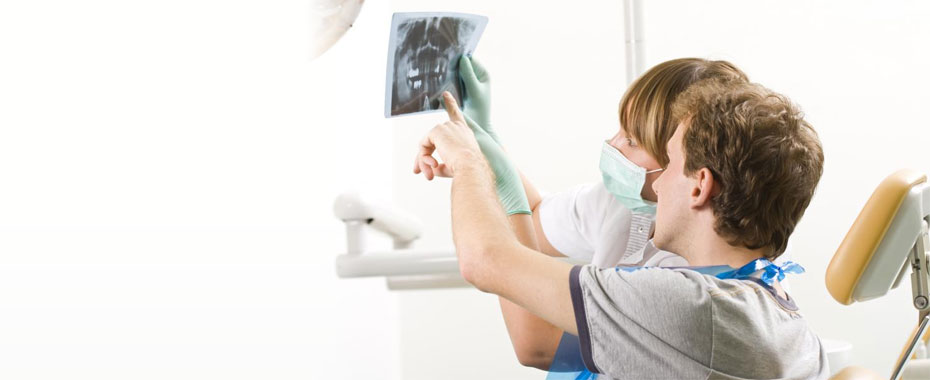 Root Canal Raleigh Therapy Dentist and Patient Examining an X-Ray