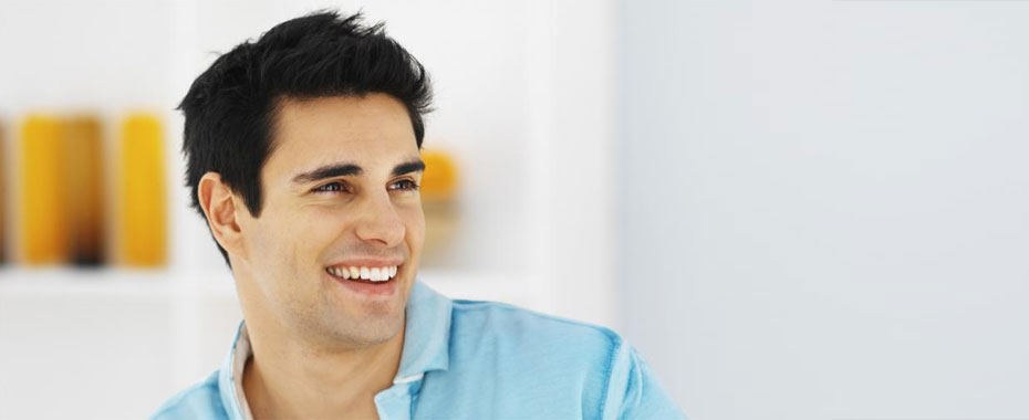 Teeth Whitening Raleigh Smiling Young Man in Blue Shirt